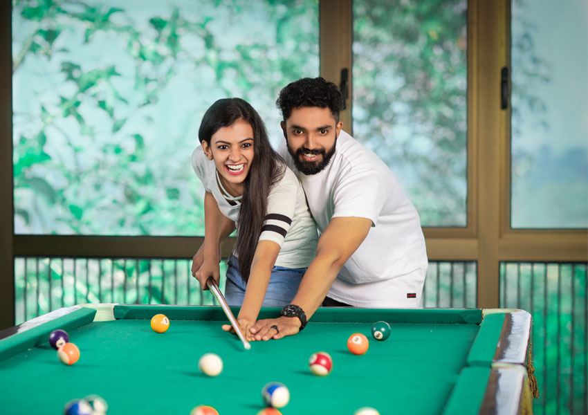 Couple Playing Billiards